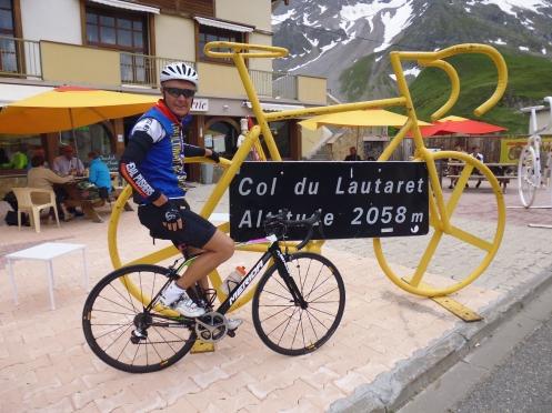 Garry Buys at yellow bike sign Col du Lautaret